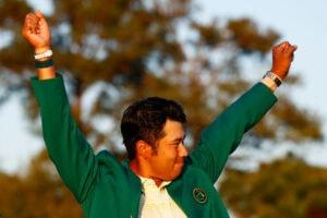 Hideki Matsuyama of Japan celebrates during the Green Jacket Ceremony